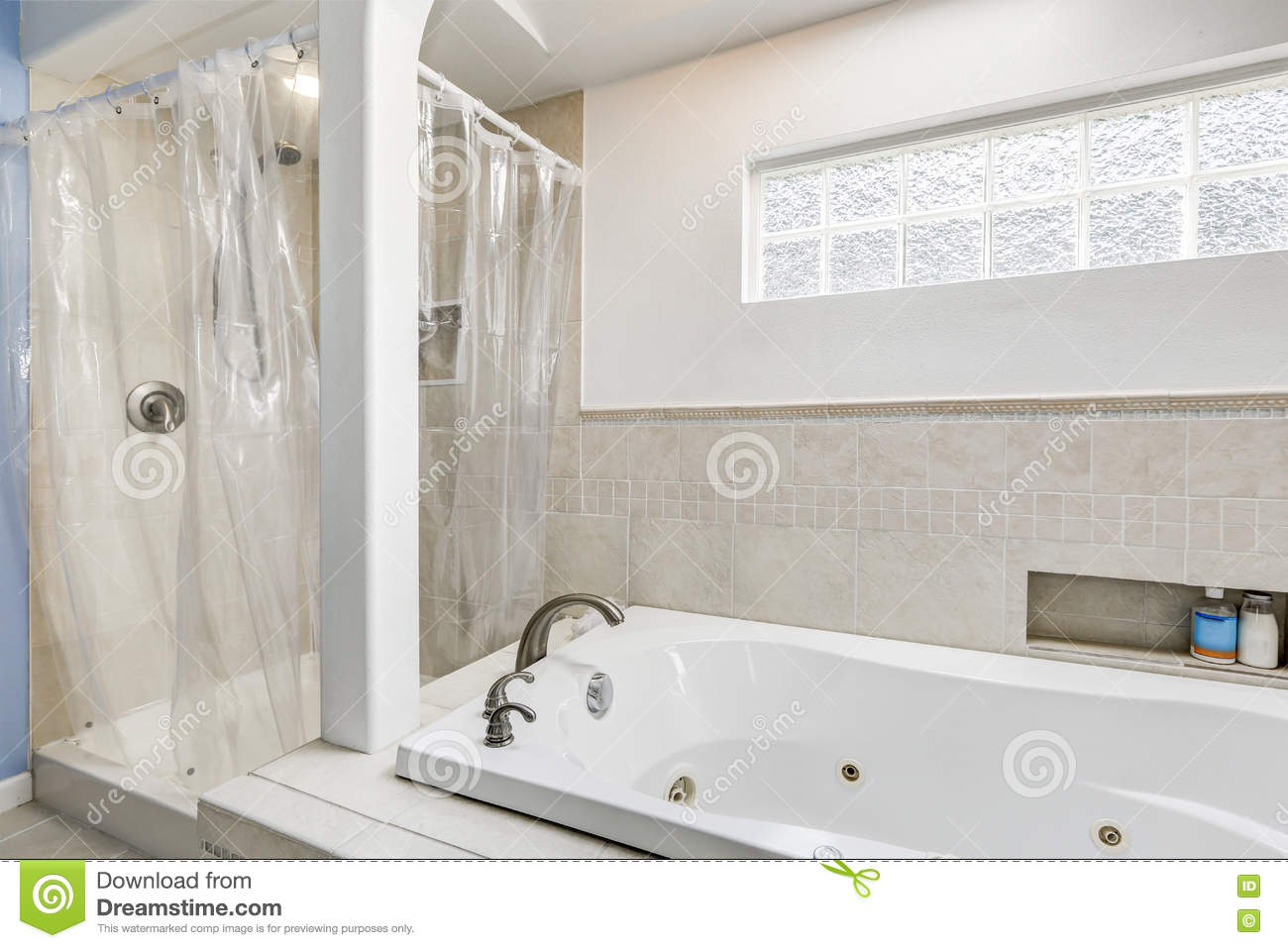 White Clean Bathroom With Beige Tile Trim And Small Window Stock ...