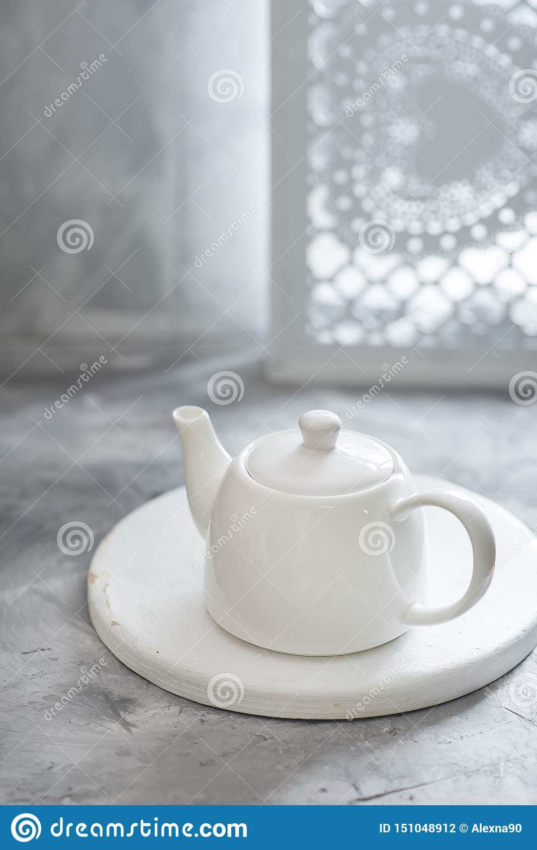 White clean porcelain teapot are on gray background