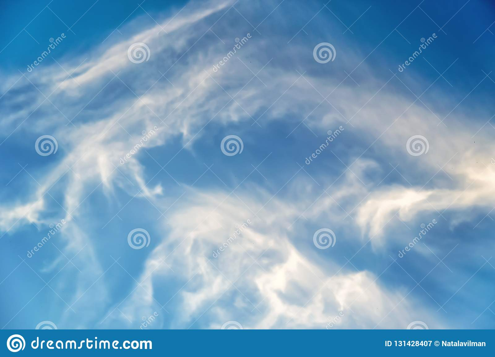 White clouds in the blue sky. Beautiful background
