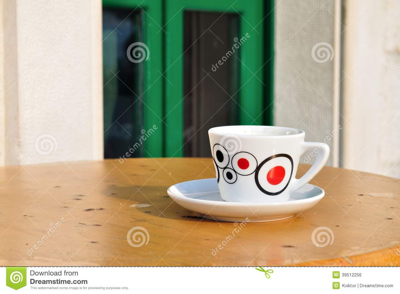 White coffee cup on a brown table