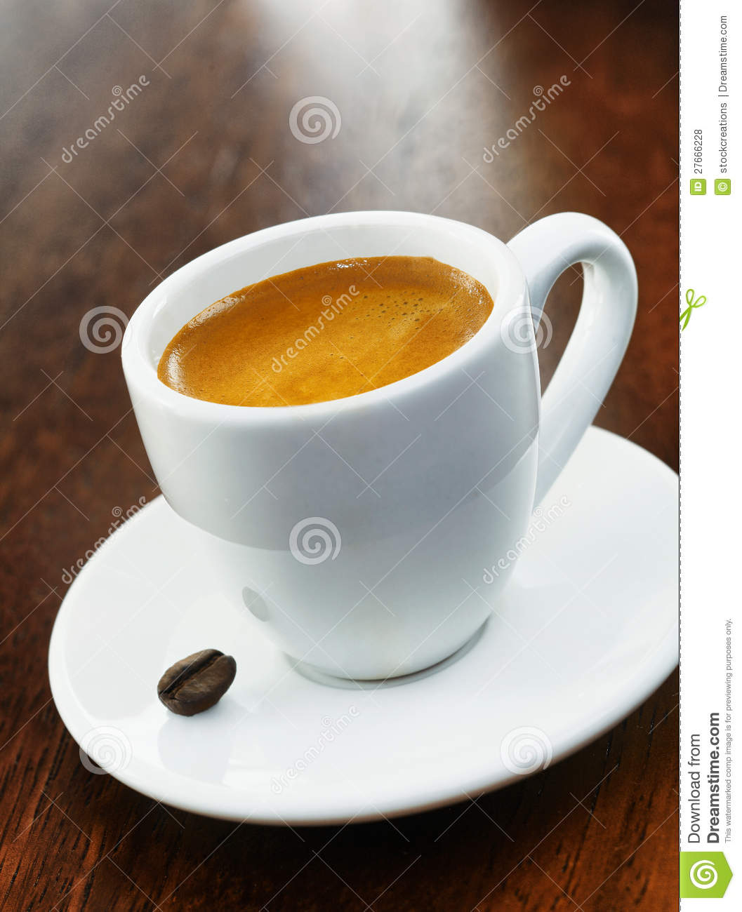 White Coffee Cup And Saucer With Single Bean Stock Photo ...