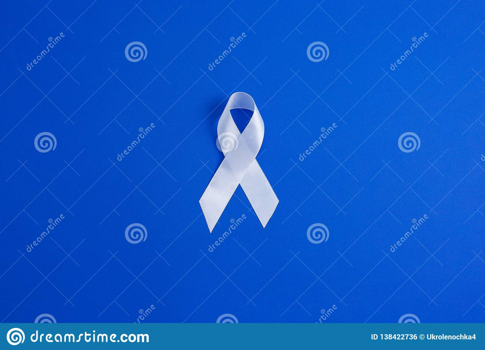 White color ribbon for raising awareness on Lung cancer and Multiple Sclerosis and international day of non-violence against women
