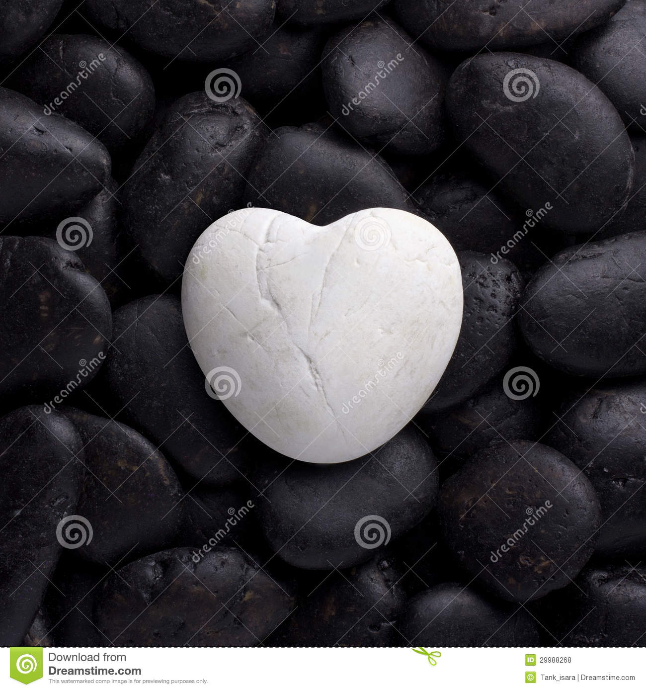 Smooth shaped white stones surface texture background stock photo - White Rock Stone In Heart Shape On Black Pebble Royalty Free Stock Photos