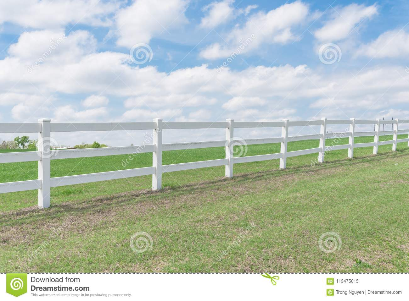 Country style wooden fence against cloud blue sky