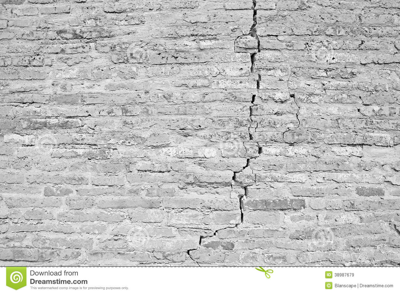 Cracked brick wall black and white