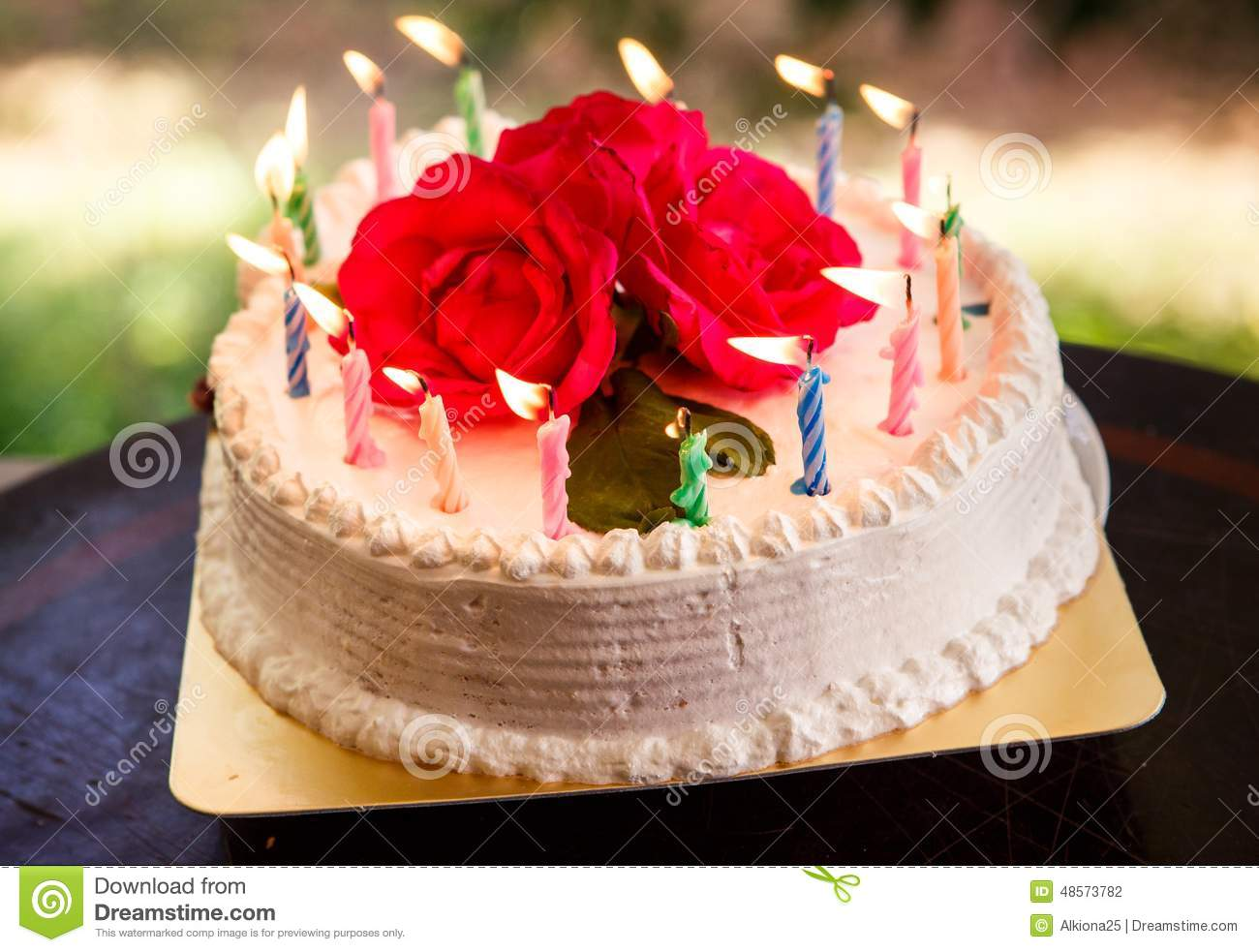 white creamy delicious cake with candles stock photo