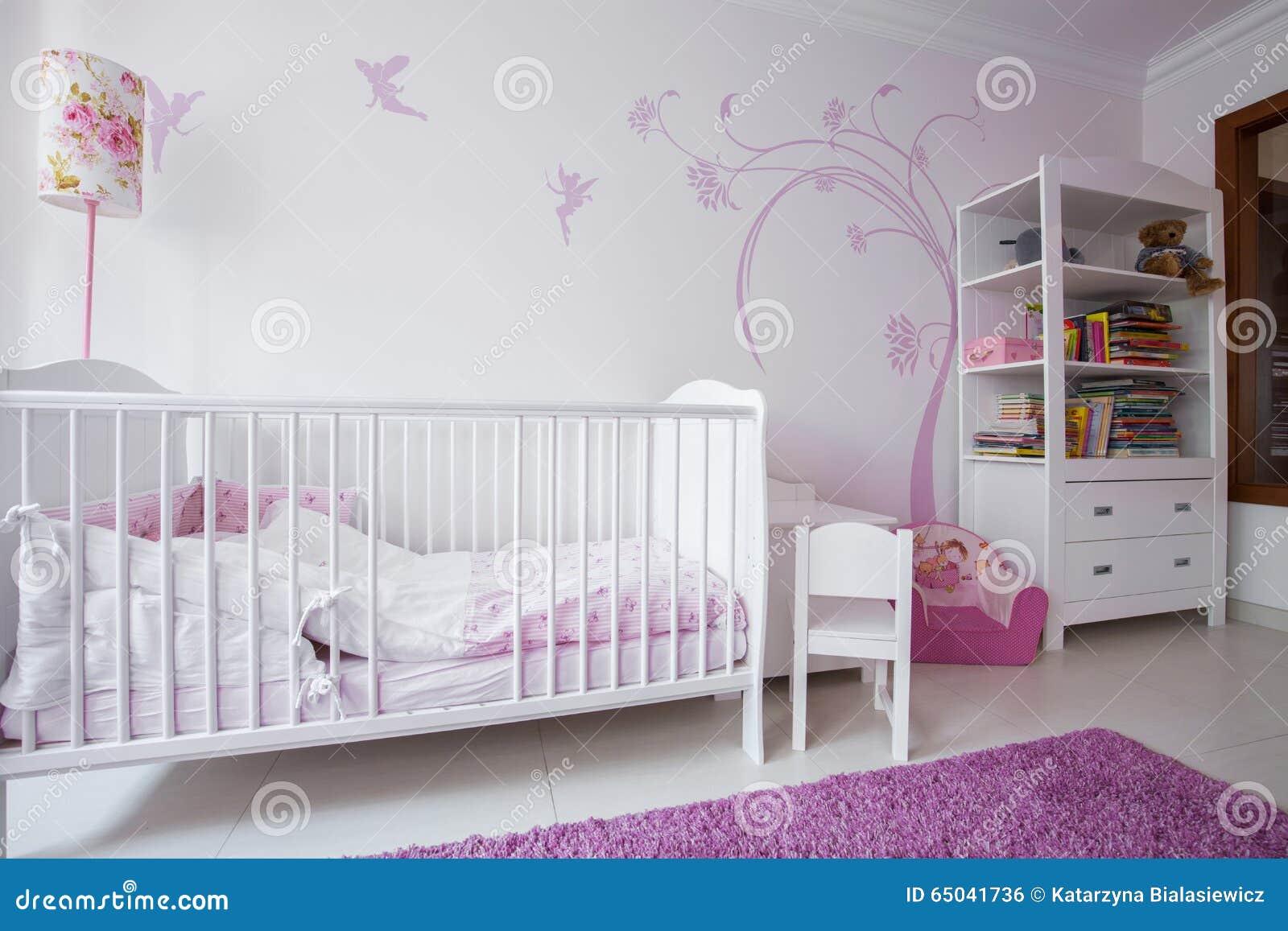 White crib in cozy nursery