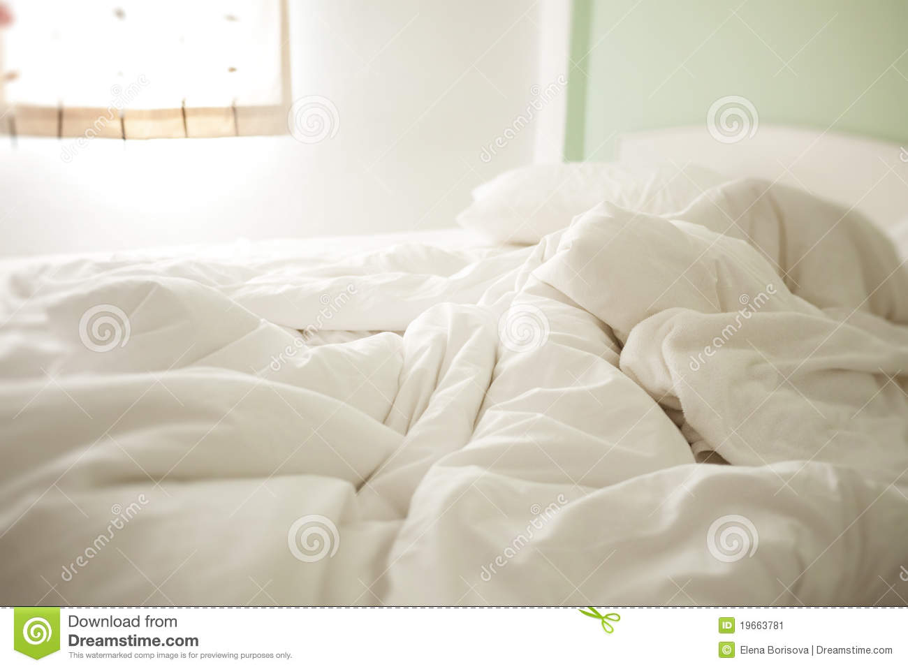 Rumpled bed sheet - White Crumpled Morning Sheets Stock Image
