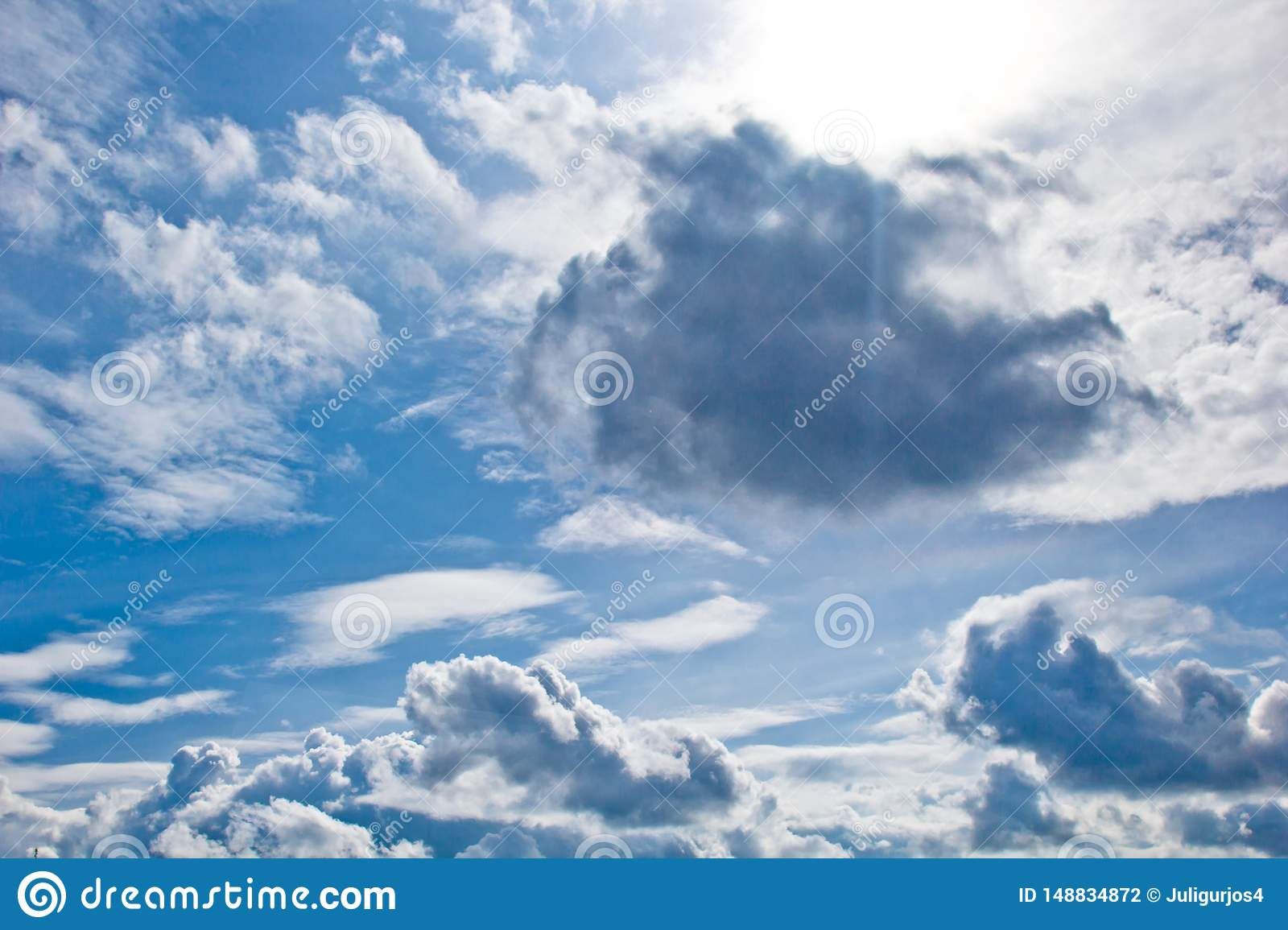 White Cumulus Clouds In The Form Of Cotton Wool On A Blue Sky ...