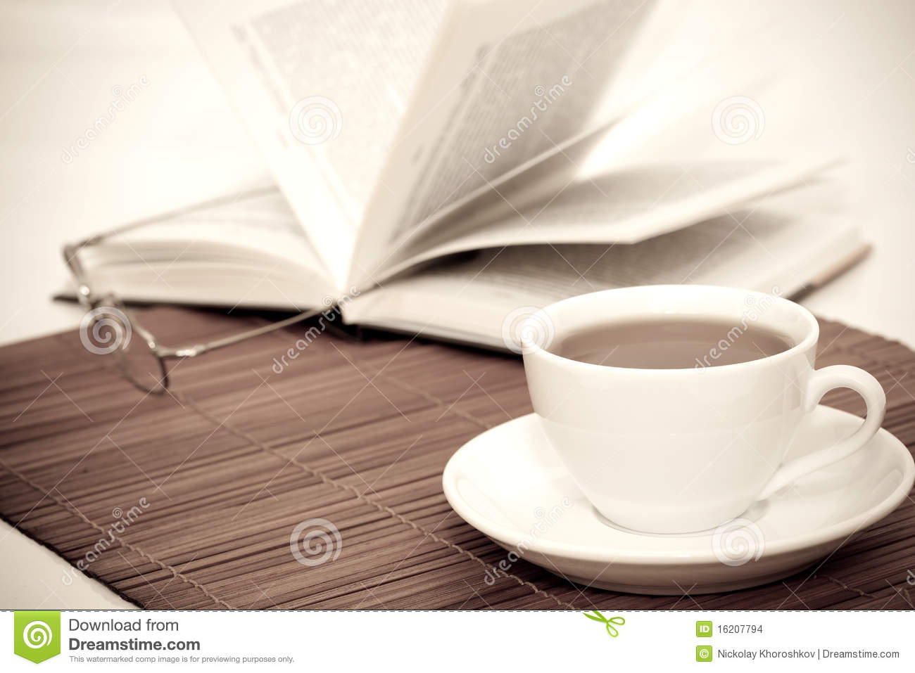 White Cup Of Coffee And Book With Glasses Stock Images