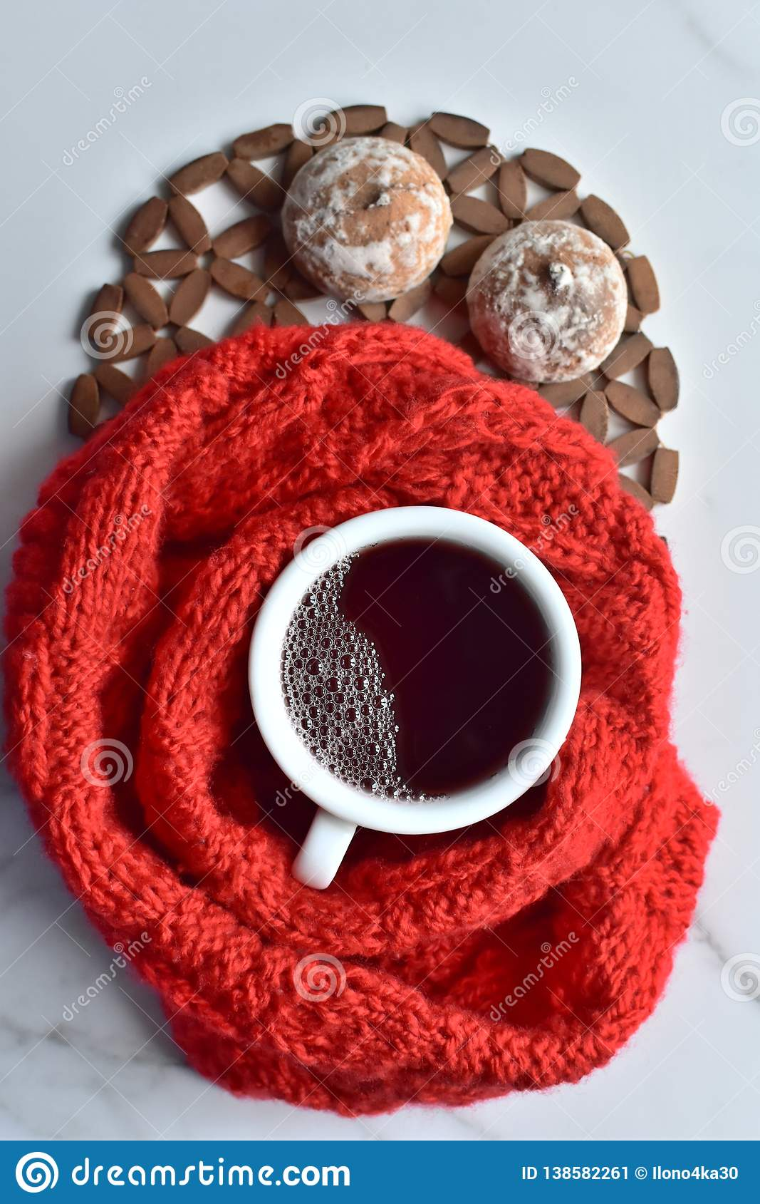 White cup of hot black coffee and sweet cookies with the red knitted cloth