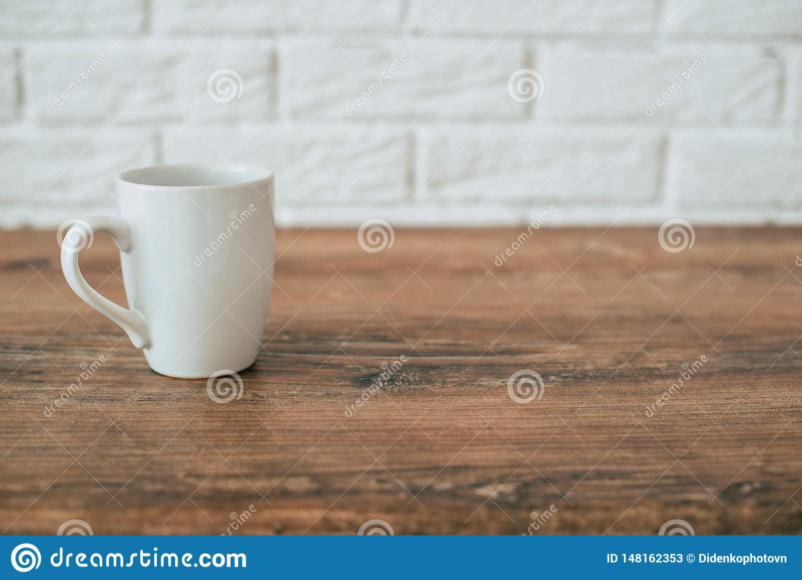 Kitchen. A cup on a wooden chair