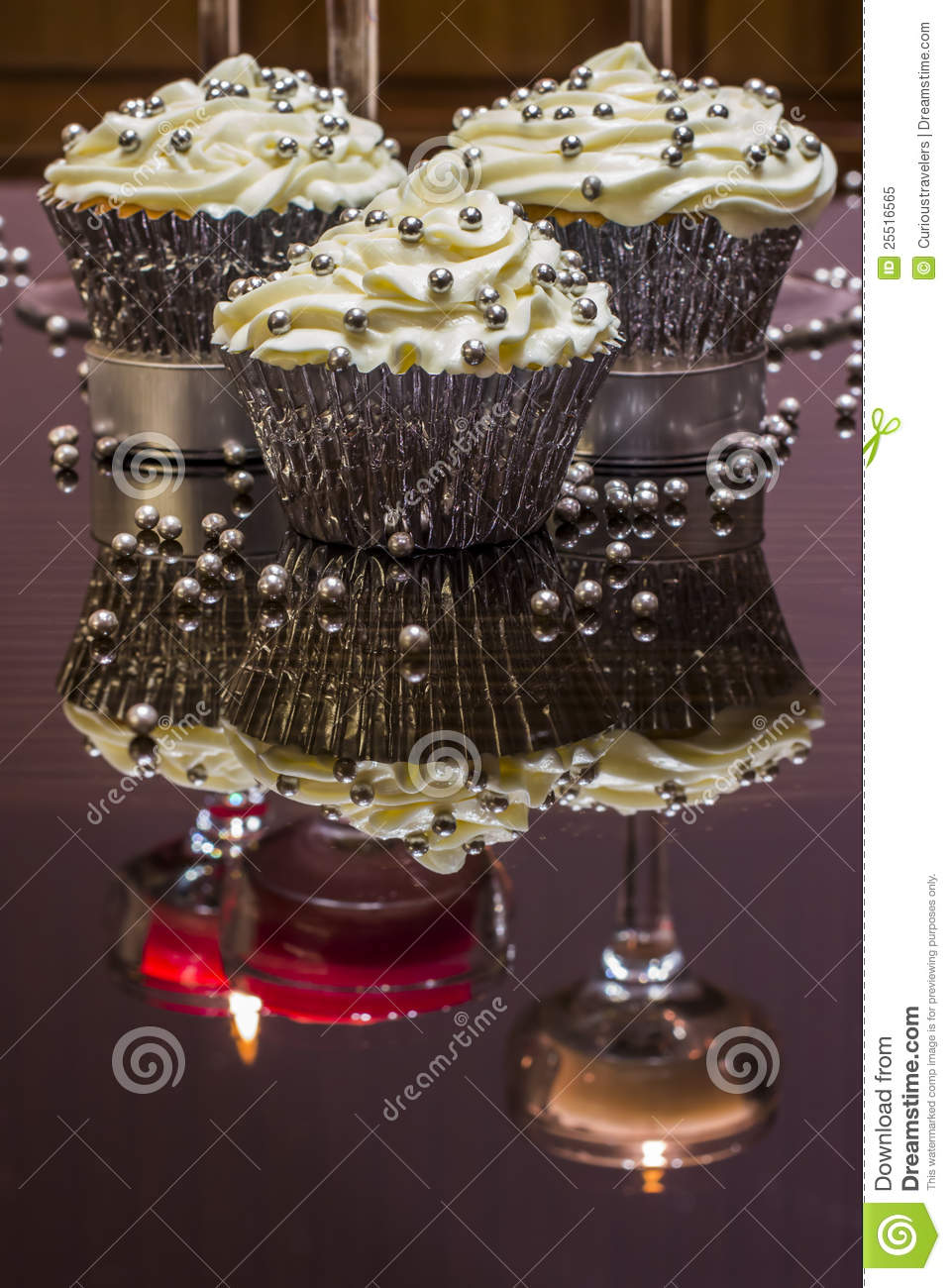 White Cupcakes With Silver Decorative Sprinkles Royalty