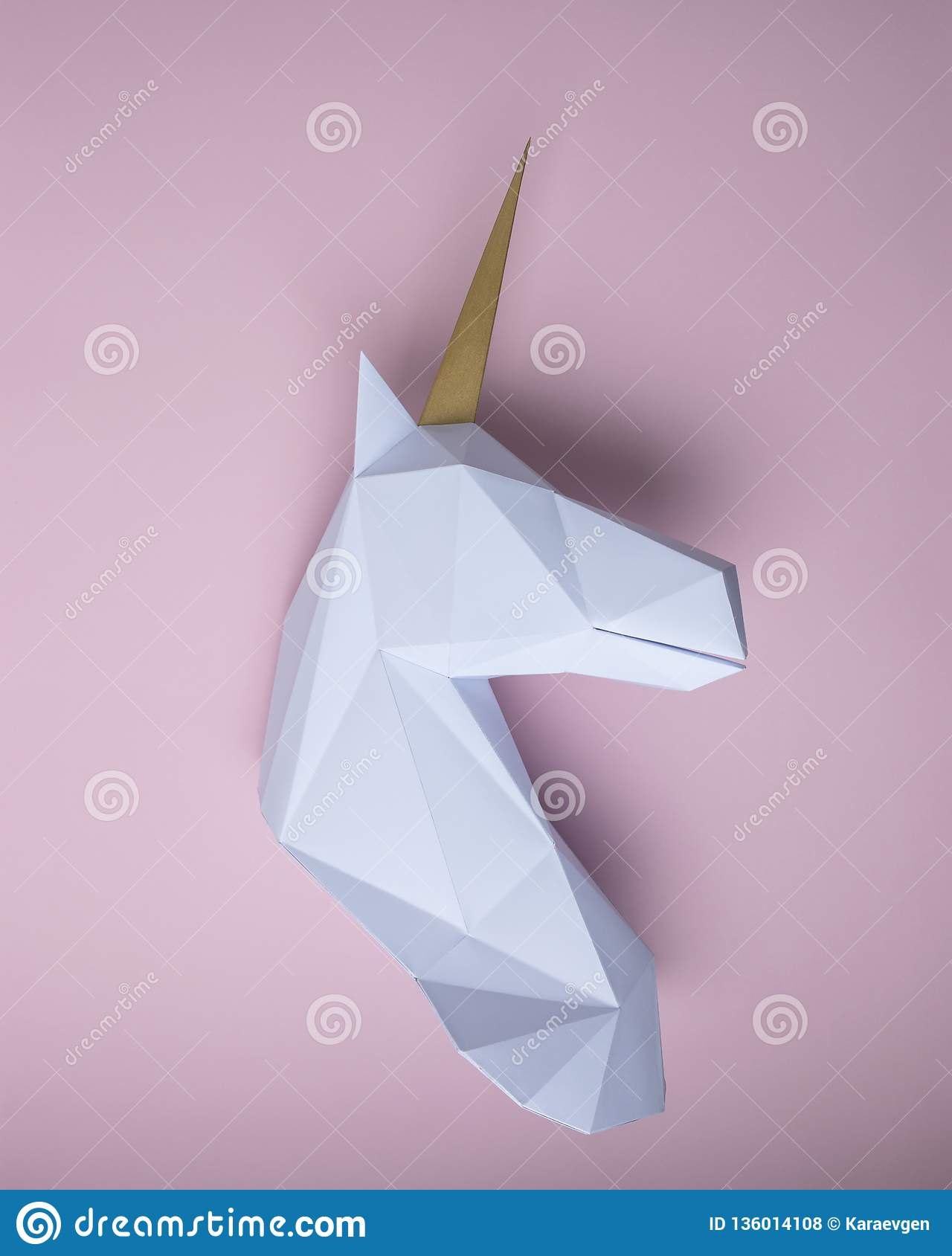 White 3d Papercraft Model Of Unicorn Head On Pink Background
