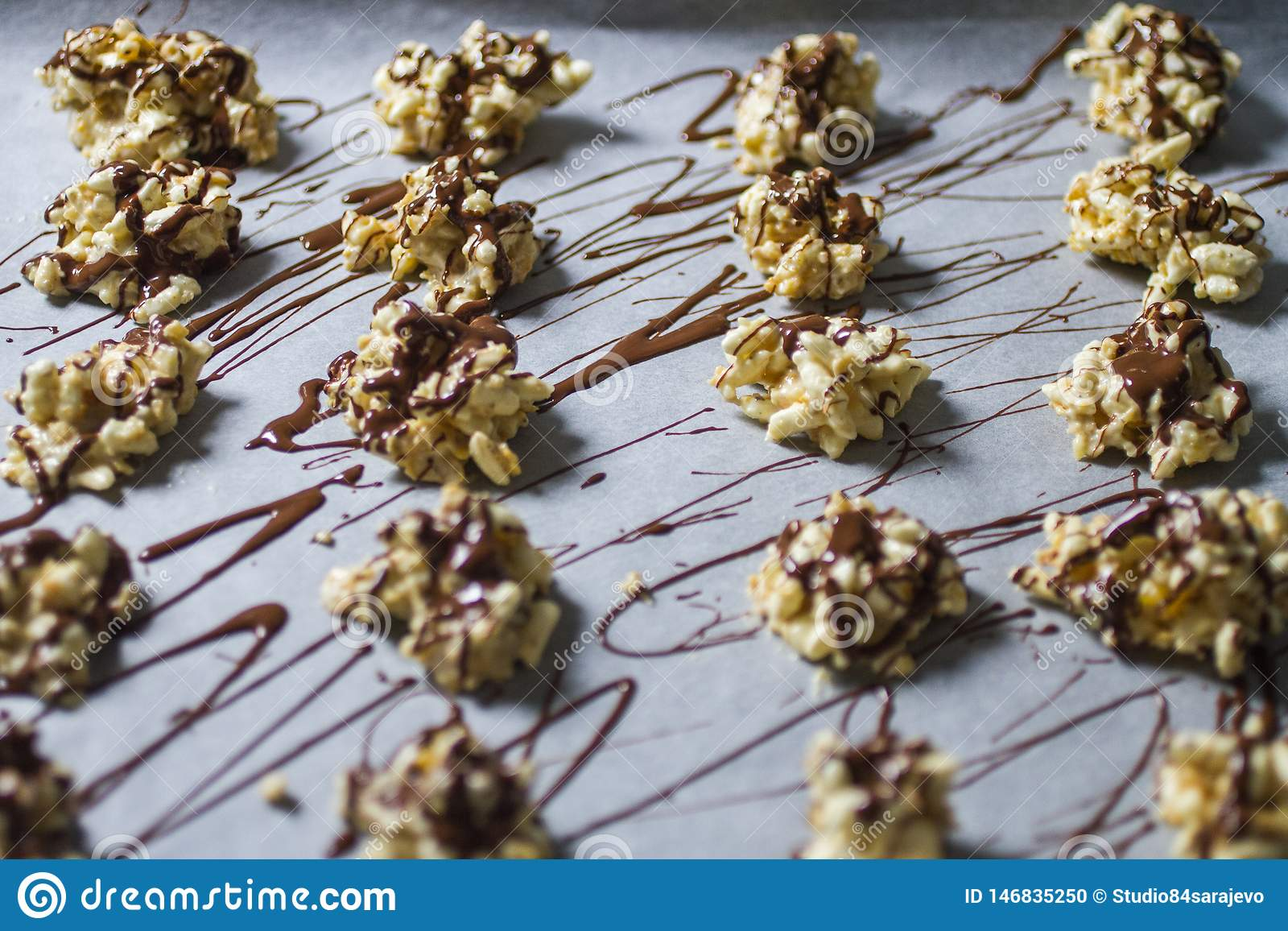White Chocolate Energy Bites Lined Up on Cooking Parchment Paper