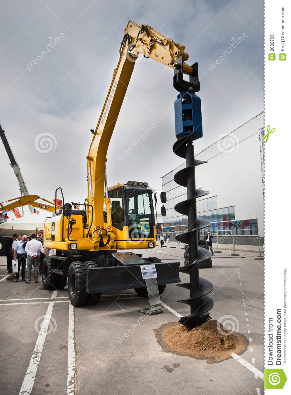 white diesel excavator digger with big earth dril