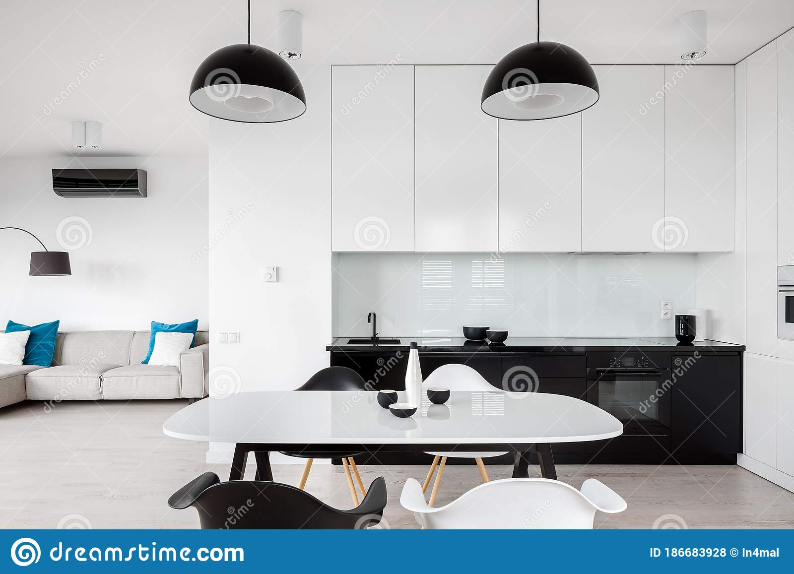 Picture of: White Dining Table In Open Kitchen Stock Photo Image Of Kitchen Indoor 186683928