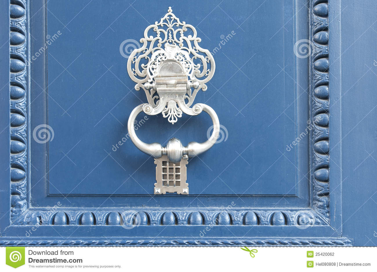 Doorknocker on blue door