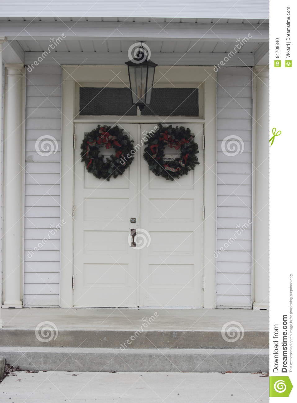 White doors with wreaths