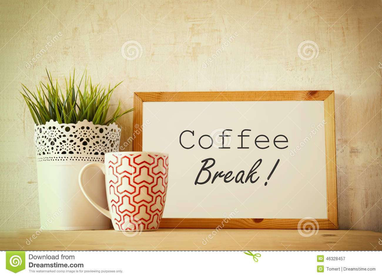 White drawing board with the phrase coffee break over wooden table ...