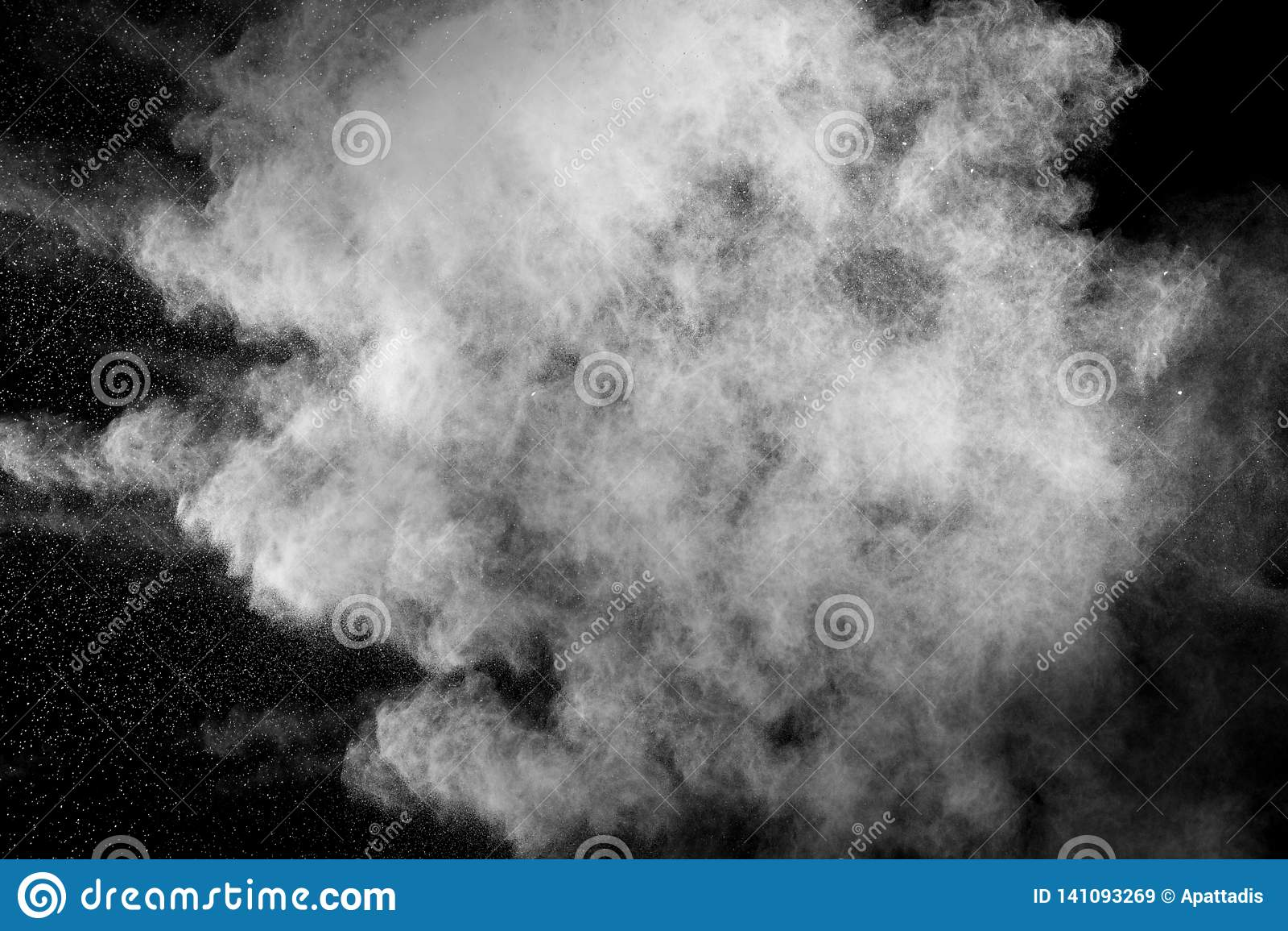 White dust exhale in the air. Motion powder spray burst in dark background