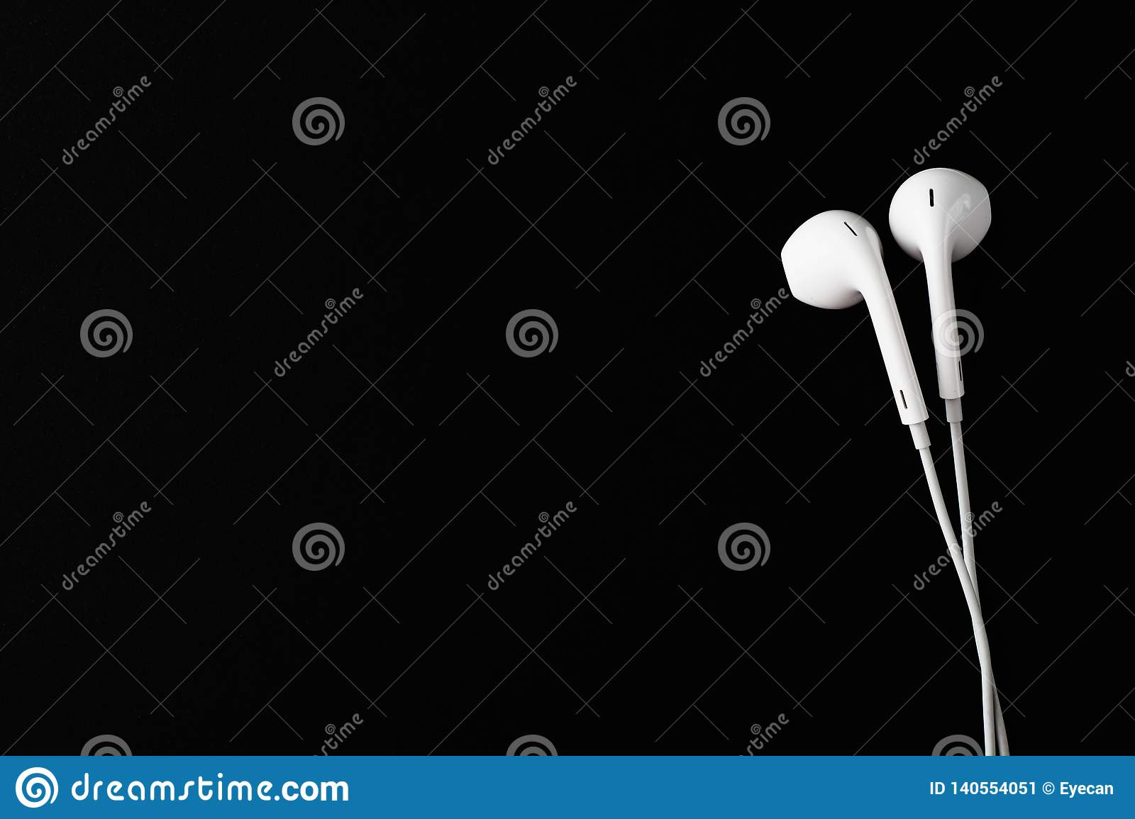 White Earbuds Or Earphones On Black Background Copy Paste Space