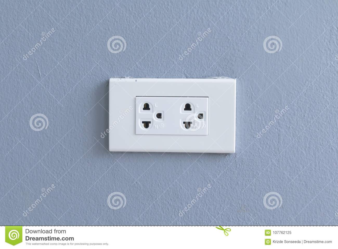 White Electric Plugs On Blue Wall Background,White Outlet Interior