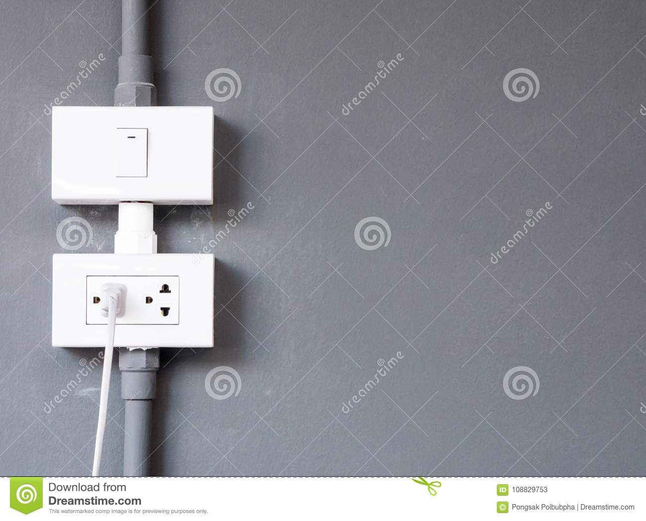 White Electrical Outlet And Light Bulb Switch. Stock Image - Image ...