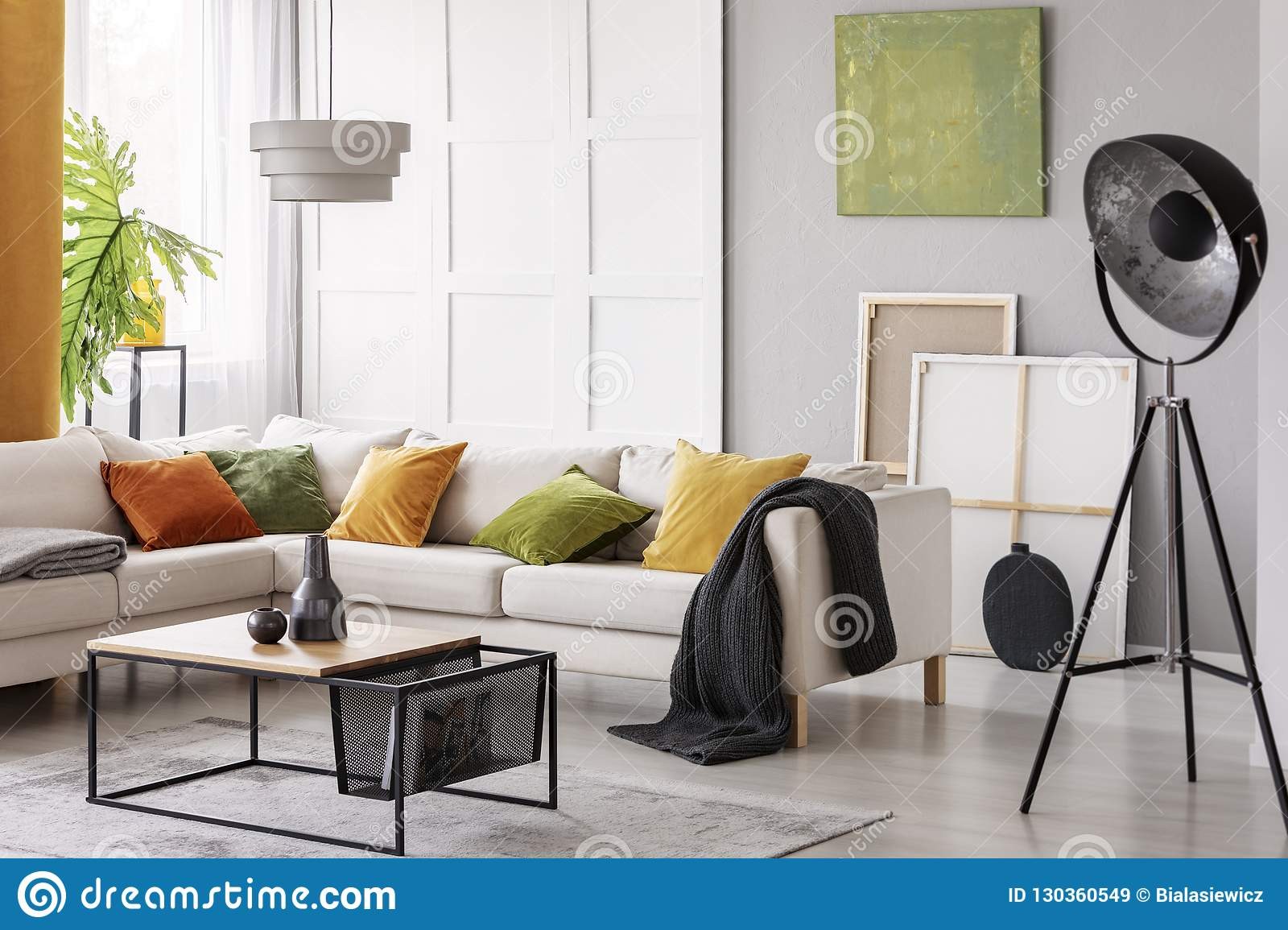 White Elegant Corner Sofa With Orange Green And Yellow Pillows In Stylish Living Room Interior With Modern Coffee Table And Indust Stock Image Image Of Living Autumn 130360549