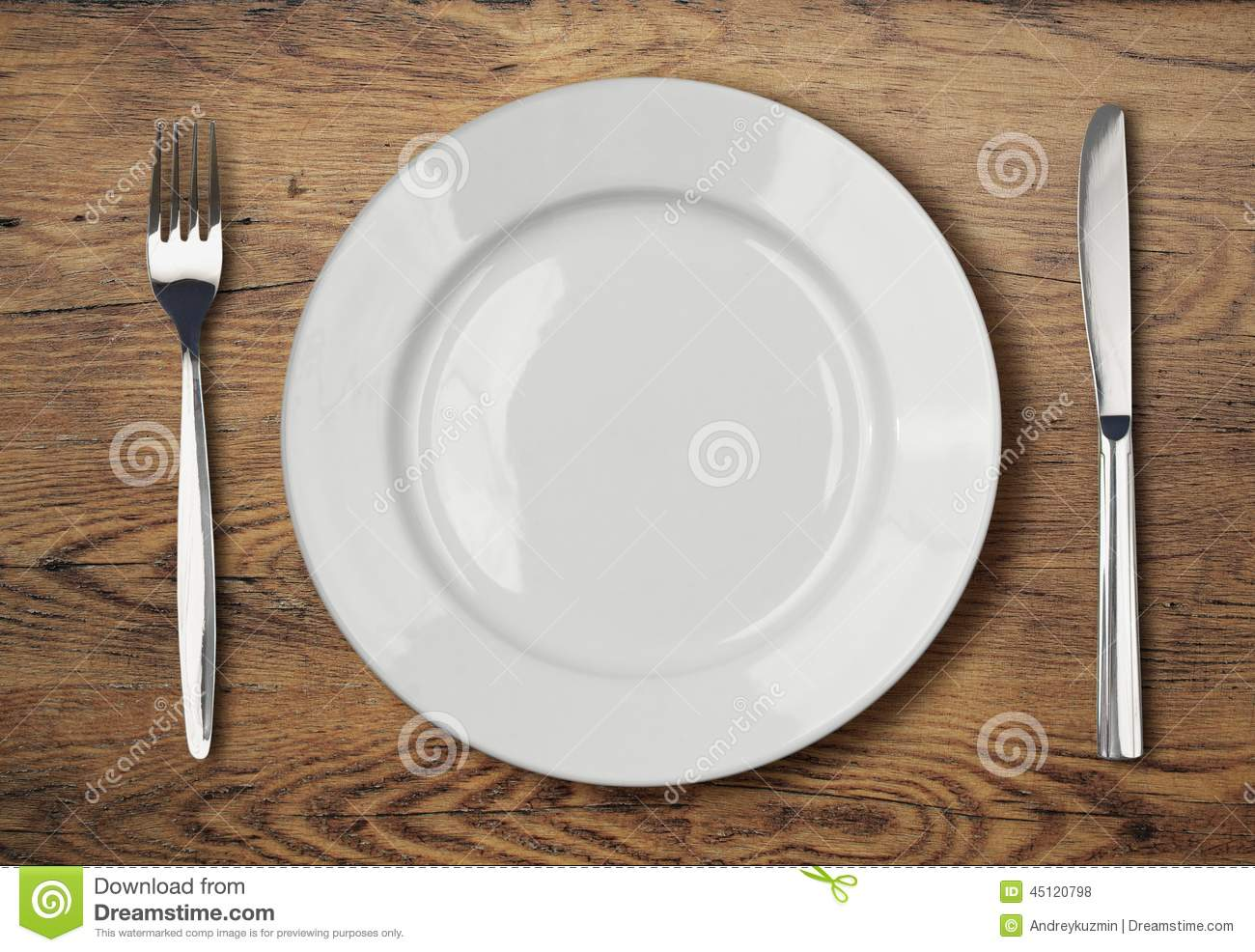 Dinner Setting white empty dinner plate setting on wooden table stock photo