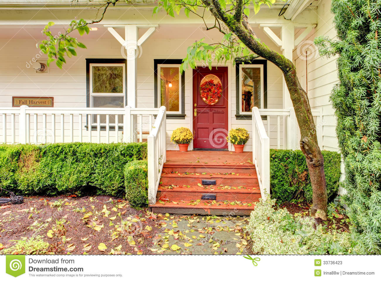 White farm house with red door during fall stock photos for Garage door repair round lake il