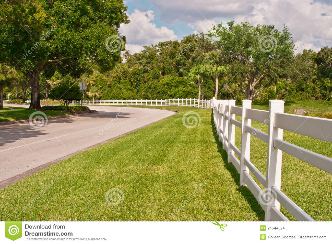 White Fence Along A Country Road