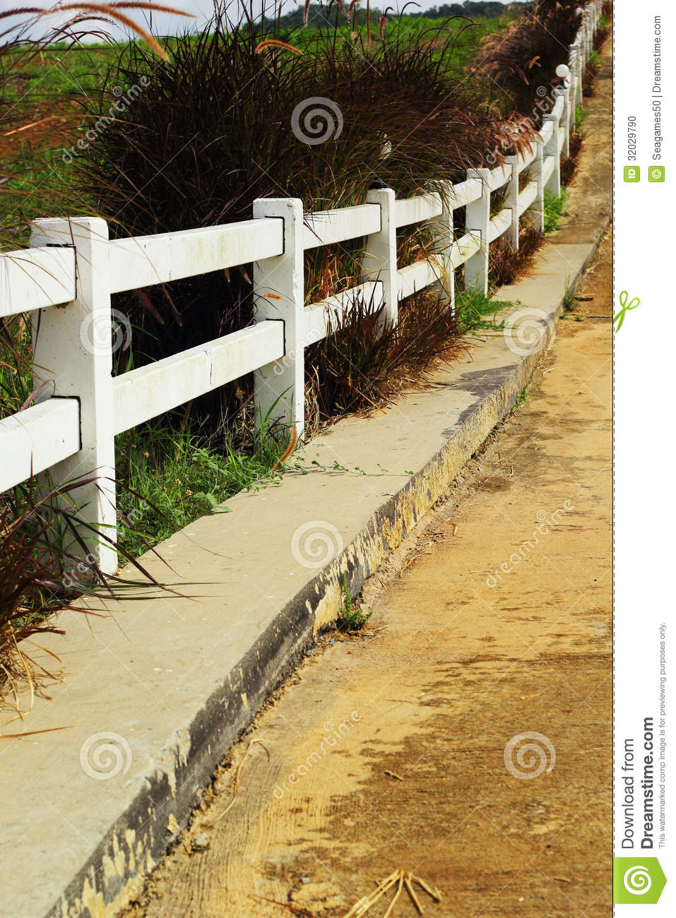 White fence with road stock photo   image: 32029790
