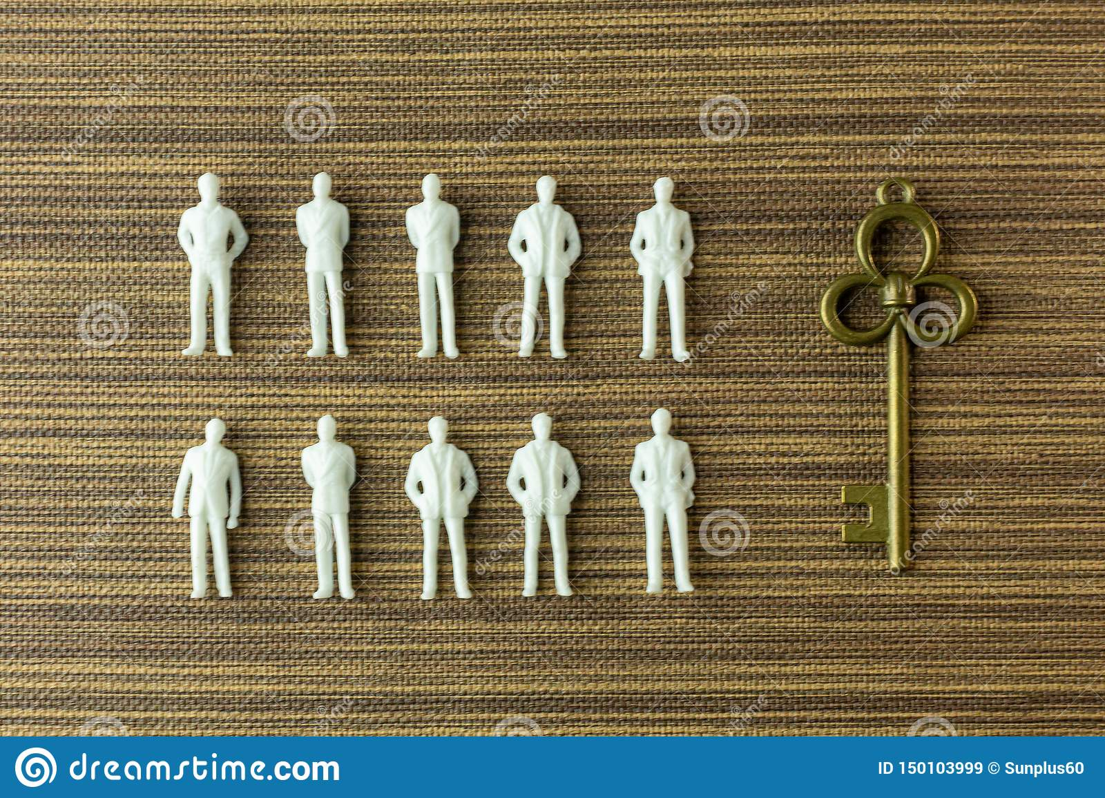 White figure miniature on wood for business content