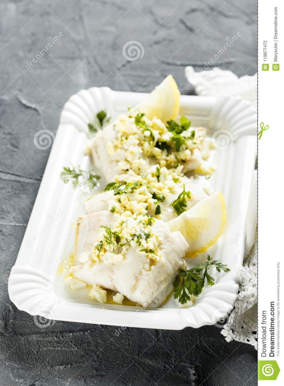 White fish cooked with parsley and lemon sauce