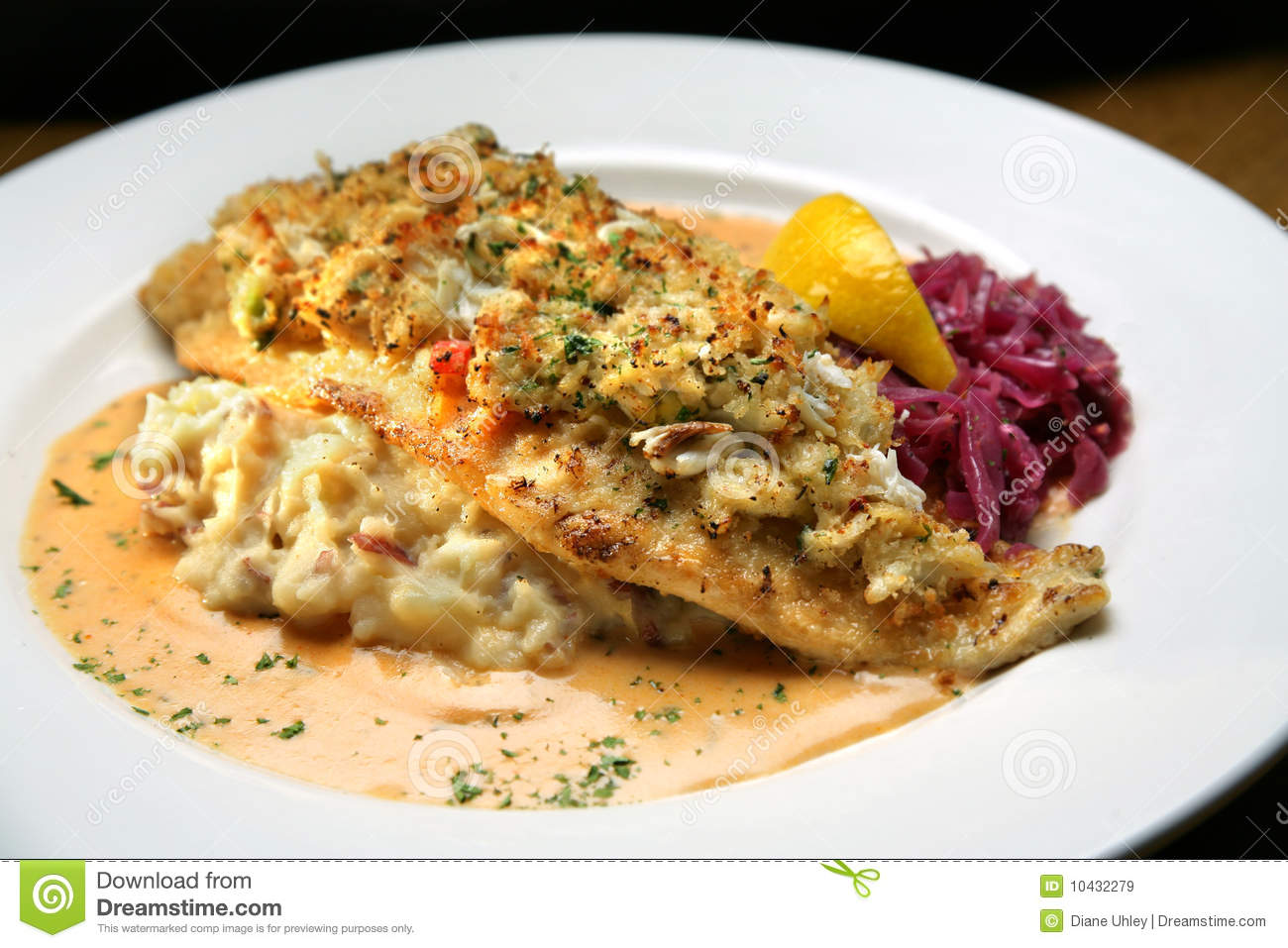 White fish covered with crab meat mashed potatoes royalty for Crab topping for fish