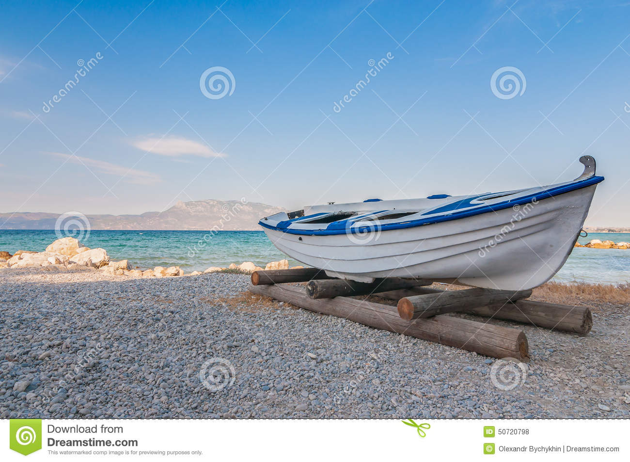 White Fishing Boat On Sand With Blue Sky And Water Stock ...