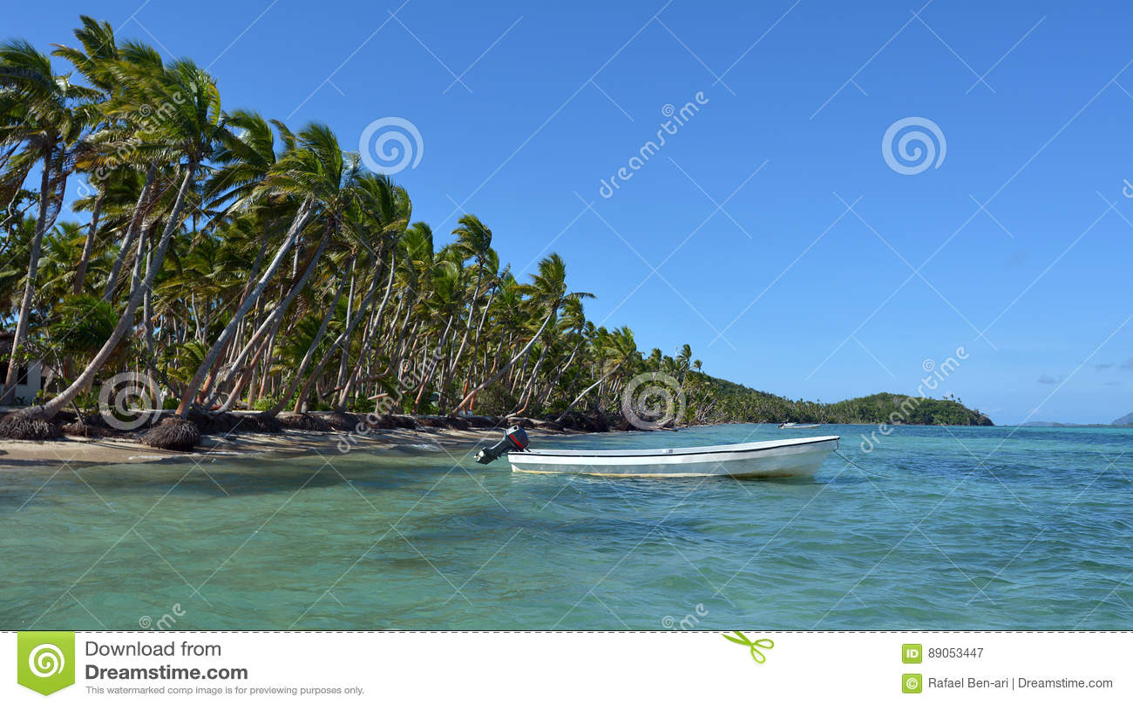 White Fishing Boat On A Tropical Island In Fiji