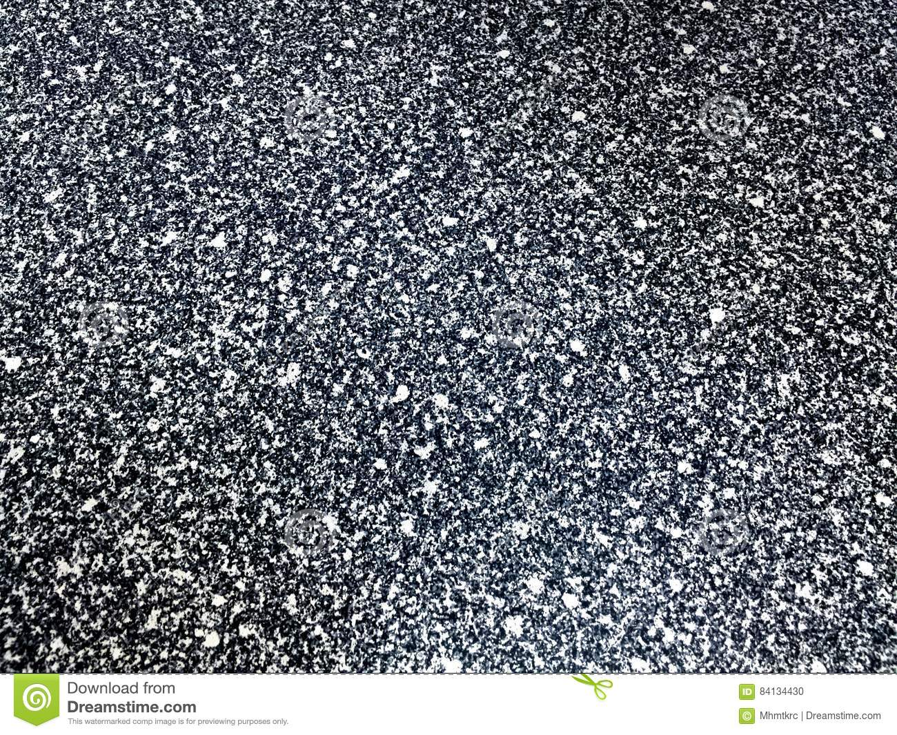 White flakes black background texture