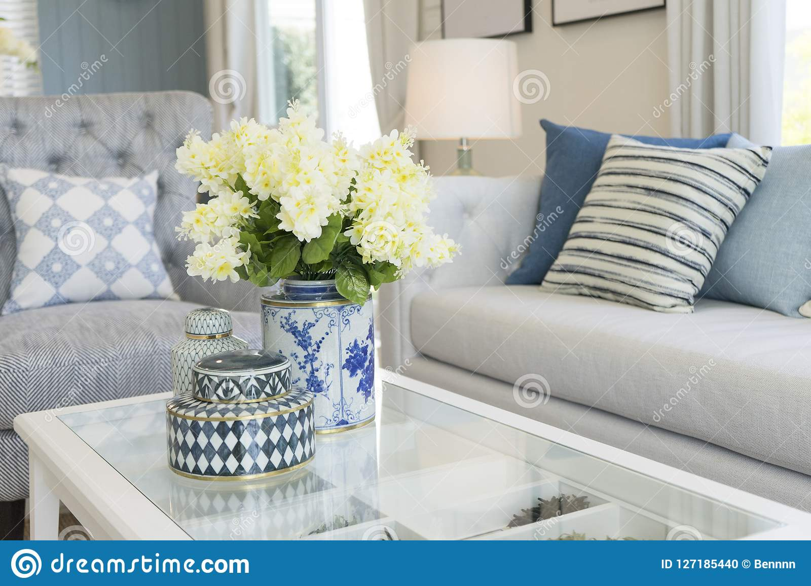 White Flower In A Vase On Table In Contemporary Living Room Stock