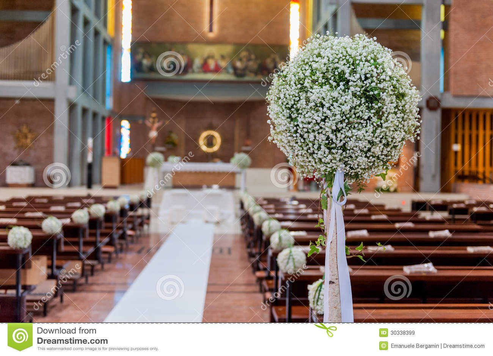 White flowers in church stock image. Image of bricks - 30338399
