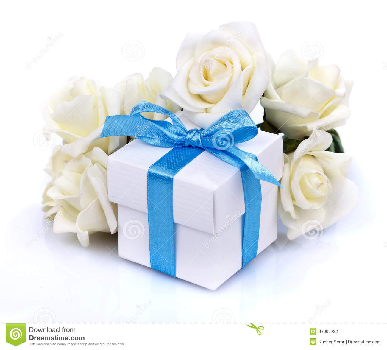 White Flowers And Gift Box With Blue Ribbon Bow On A Background