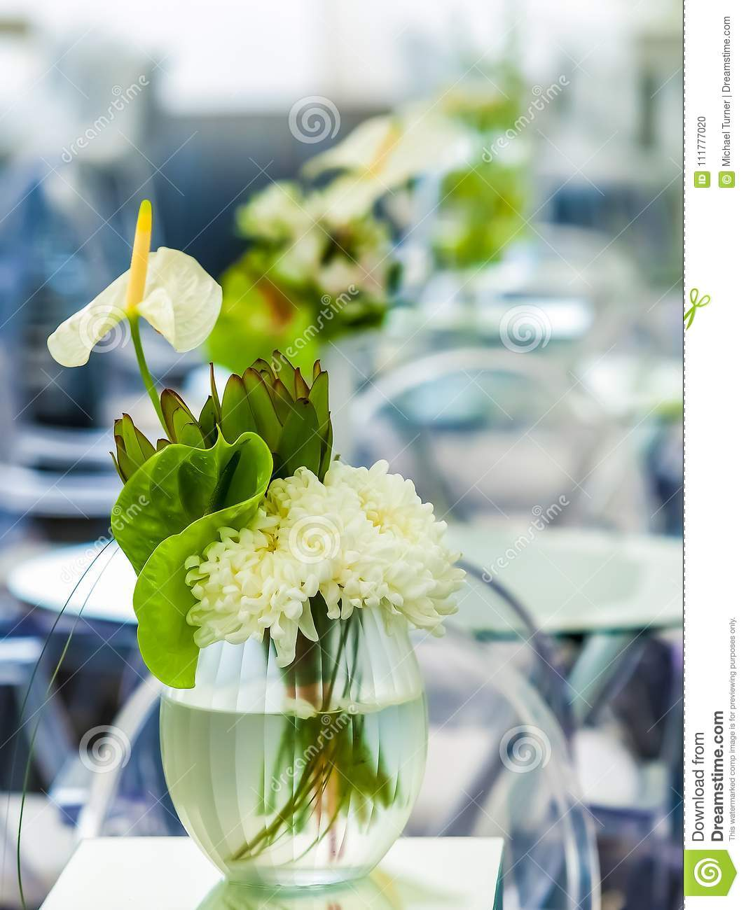 White flowers on a table setting for event or party with lilies