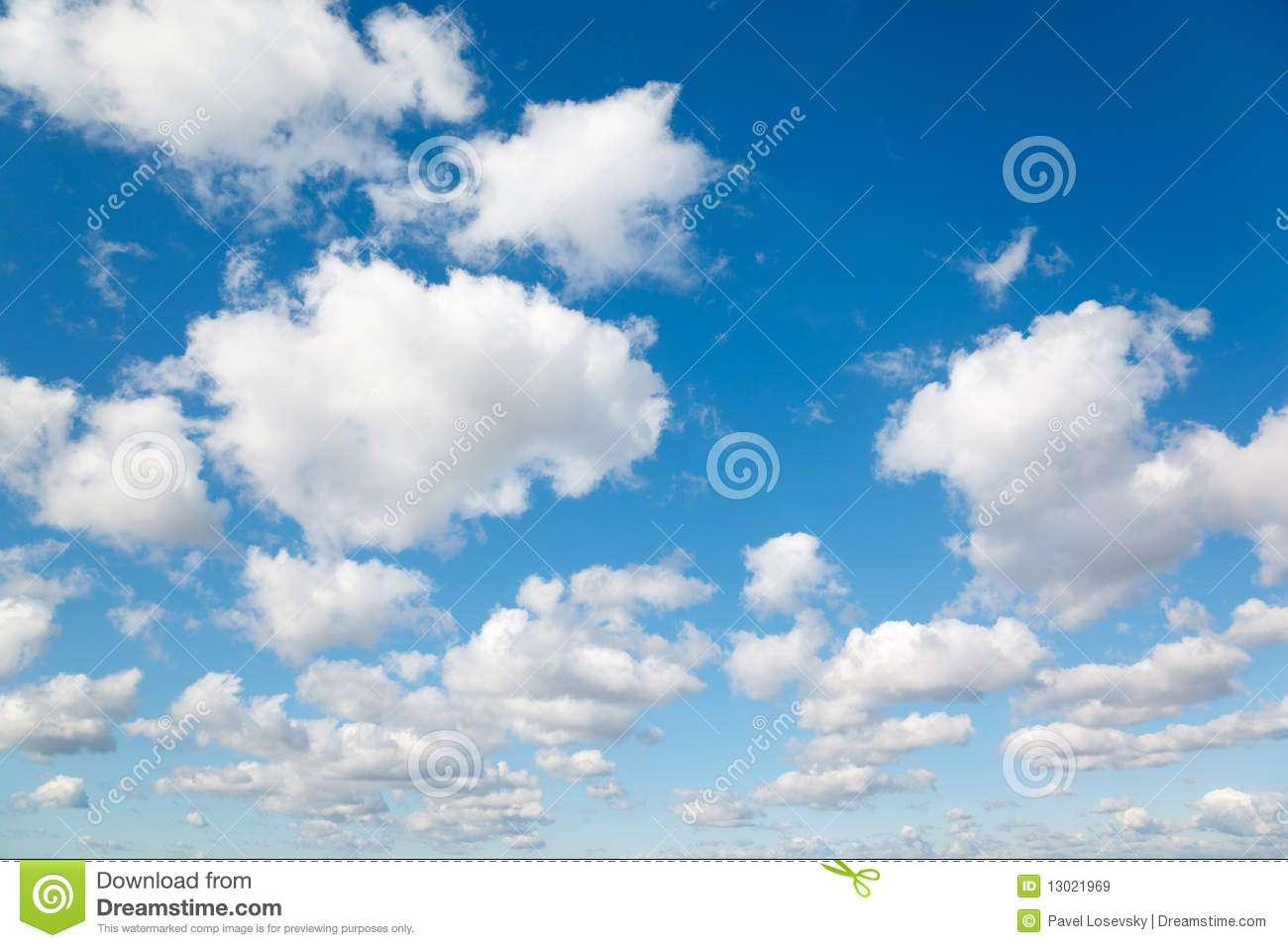White, fluffy clouds in blue sky.