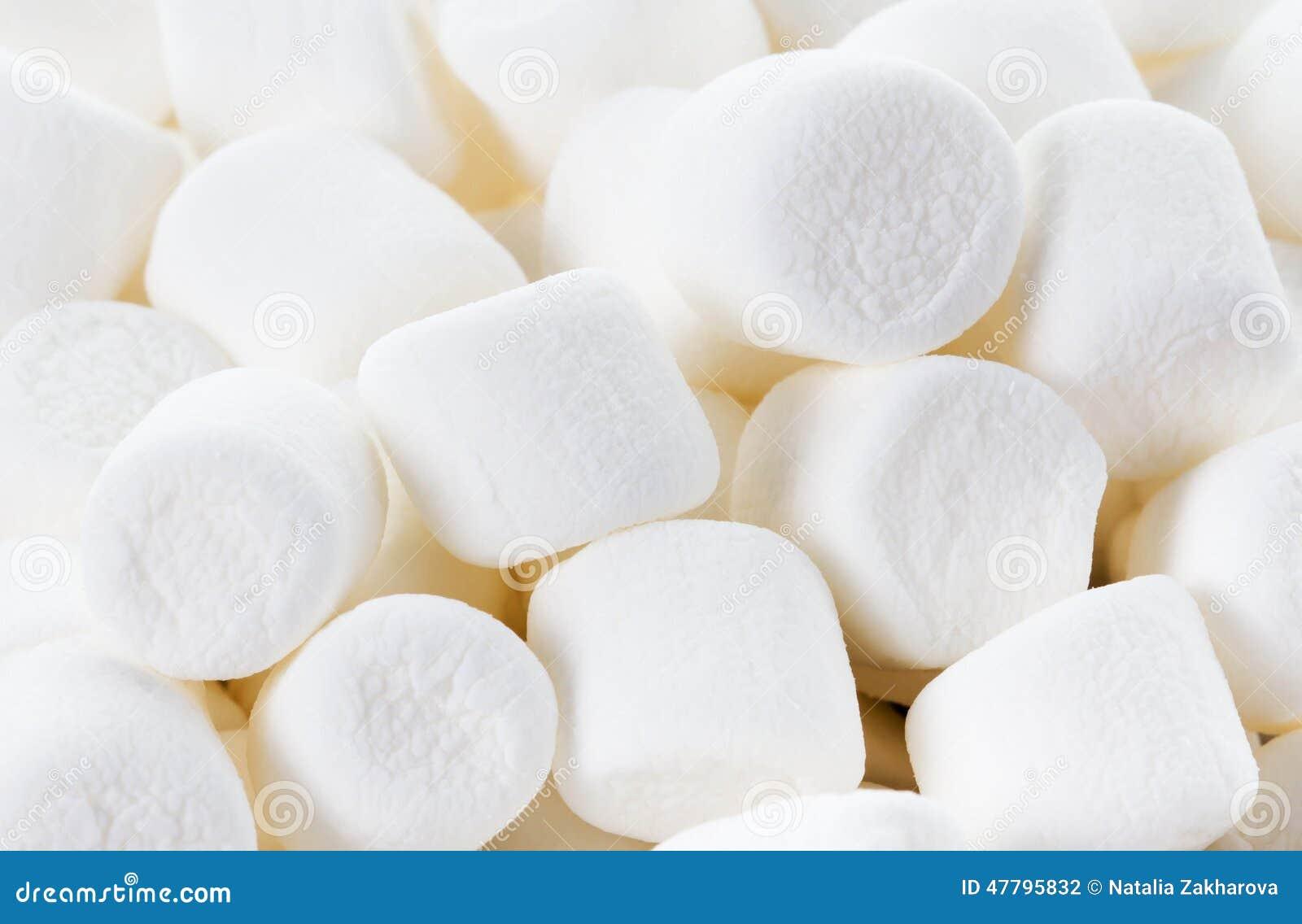 white fluffy round marshmallows as a background sweet food ca stockwhite fluffy round marshmallows as a background sweet food candy background as poster wallpaper, backdrop macro