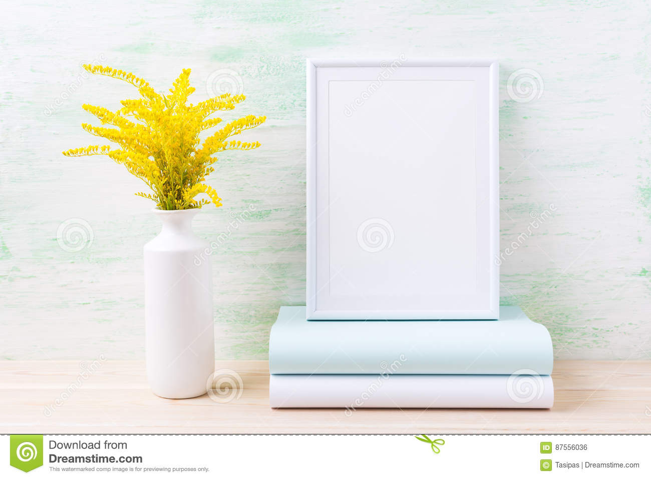 White frame mockup with ornamental golden grass and books