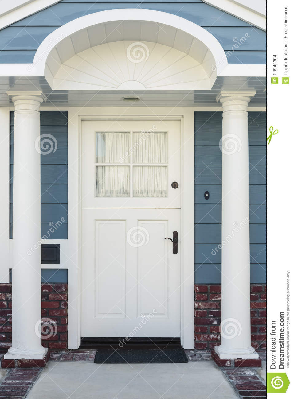 White front door of classical blue and brick home stock for White front door