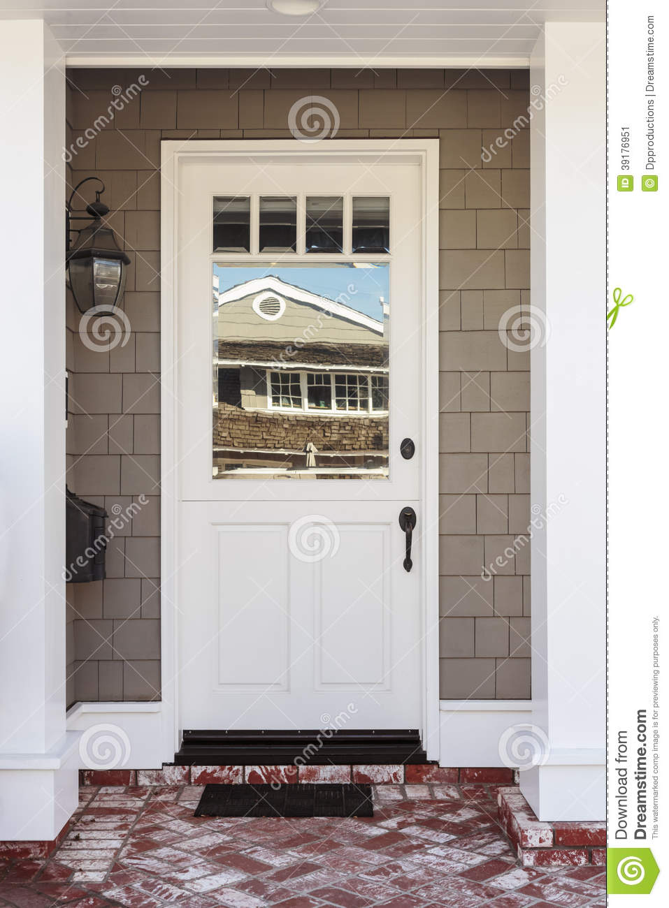White Front Door With Red And White Brick Porch Stock