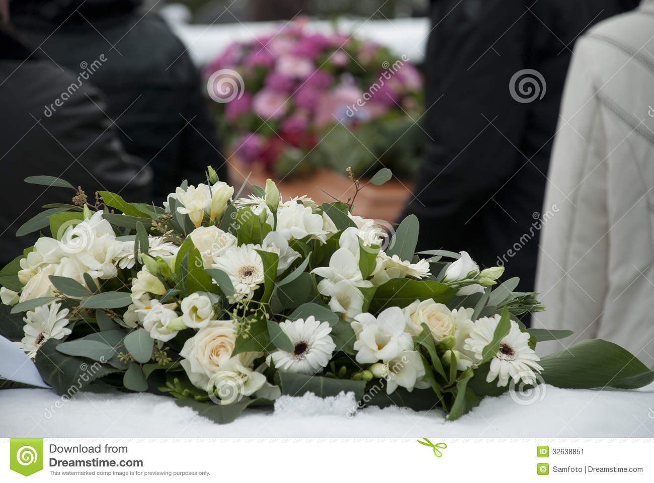 White funeral flowers in the snow before a caket stock image image white funeral flowers in the snow before a caket izmirmasajfo