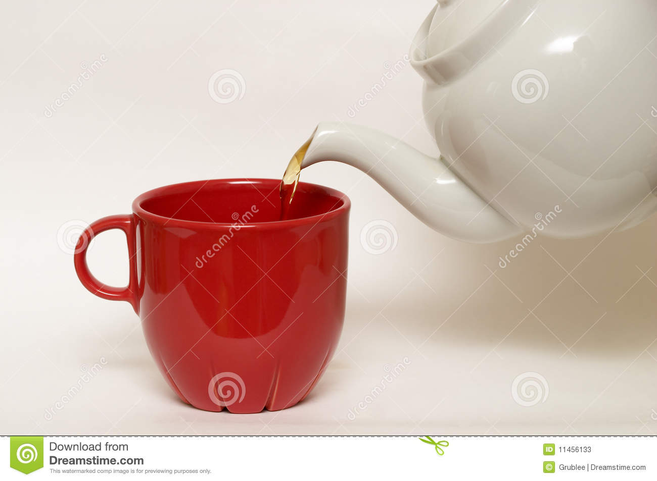 White glazed faience tea pot and red cup stock image image of